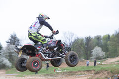 Rear view of quad rider in jumping Stock Photo