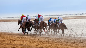 Rear view racing jockeys at Sanlucar de Barrameda Royalty Free Stock Images