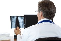 Rear view of radiologist examining radiography Stock Photography