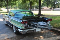 Rear view of a rare 1958 Pontiac Bonneville. The Bonneville name first appeared in 1954 on a pair of bubble-topped GM Motorama concept cars called the Bonneville royalty free stock images