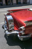 Rear view of a red classic american car in Cuba. Detail of a red classic american car under perfect conditions Stock Photos
