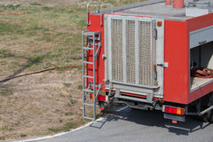 Rear view of red fire truck Stock Photography