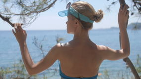 Rear view of relaxed woman on summer travel vacation to the coast sea. stock video