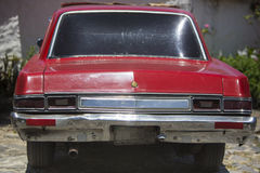Rear view of retro red car and light reflections, Venezuela Royalty Free Stock Images