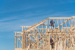 Close-up two-story stick built home with building contractor car stock photo