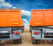 Rear view through rows of tippers Stock Photography