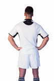 Rear view of rugby player with arms on waist Stock Photo