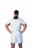 Rear view of a rugby player with hands on waist Royalty Free Stock Images