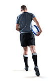 Rear view of rugby player running with ball Royalty Free Stock Photo