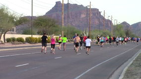 Rear view of runners participating in a marathon stock video footage
