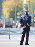 Rear view of Russian road policeman in uniform outdoor. KEMEROVO RUSSIA SEPTEMBER 18 2016. Rear view of Russian road policeman in uniform outdoor stock images