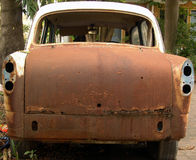Rear view of an abandoned rusty car. Rear view of an old and abandoned rusty car Royalty Free Stock Images