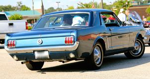 Rear view of a 1960's model Blue Ford mustang Stock Images