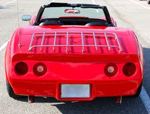 Rear view of 1970's model red antique Corvette. 1970's model red corvette in  pristine showroom condition Royalty Free Stock Photography