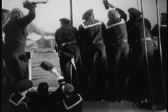 Rear view of sailors waving to submarine stock video