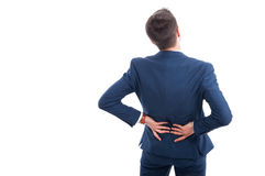 Rear view of salesman suffering from backache. Massaging his lumbago isolated on white background with copyspace Royalty Free Stock Photography