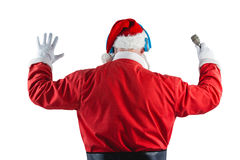 Rear view of santa claus listening to music. Against white background Stock Images
