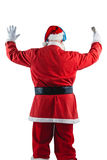 Rear view of santa claus listening to music. Against white background Royalty Free Stock Photography