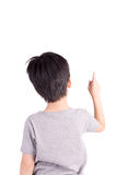 Rear view of a school boy over white background pointing upwards. Half length portrait Stock Images