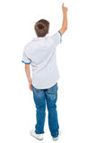 Rear view of a school boy pointing upwards Stock Photography