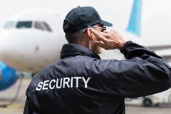 Rear View Of A Security Guard. Wearing Black Jacket stock photos