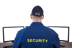 Rear view of security officer using computer Royalty Free Stock Image