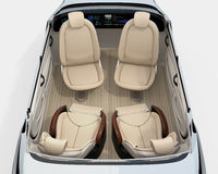Rear view of self-driving car cutaway image. Front seats turn to backward, and the rear seats have gorgeous reclining massage function. 3D rendering image Royalty Free Stock Images