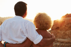 Rear View Of Senior Couple Watching Sunset Over Port Stock Photography