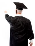 Rear view of a senior male graduate pretending to work on virtua Stock Photos