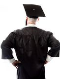 Rear view of a senior male graduate standing with arms akimbo Royalty Free Stock Photography