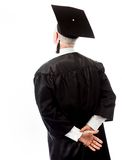 Rear view of a senior male graduate standing with hands behind b Stock Photography