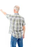 Rear view of a senior man blaming somebody Royalty Free Stock Photos
