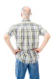 Rear view of a senior man standing with his arms akimbo Royalty Free Stock Photo