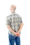 Rear view of a senior man thinking Stock Images