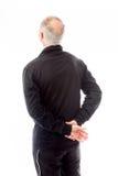 Rear view of a senior man thinking Stock Image