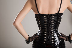 Rear view of sexy fetish woman in black corset Stock Images