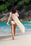 Rear view of sexy Slim woman walking at a beach Royalty Free Stock Photo