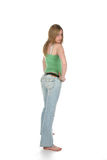 Rear view of woman in faded blue jeans Royalty Free Stock Images