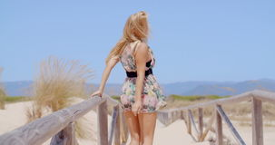 Rear View of a Sexy Woman Walking on Beach Pathway stock video