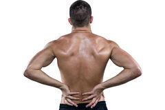 Rear view of shirtless athlete with back pain Royalty Free Stock Images