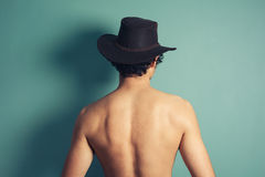 Rear view of shirtless cowboy Royalty Free Stock Photo
