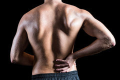 Rear view of shirtless man with back pain Stock Images