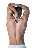 Rear view of shirtless man suffering from back pain Royalty Free Stock Images