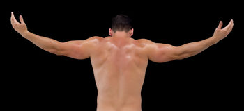Rear view of shirtless muscular man with arms raised Royalty Free Stock Images