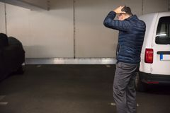 Rear View Of A Shocked Man Standing In Parking Lot royalty free stock photography
