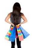 Rear view of a shopping woman Royalty Free Stock Images