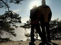 Rear view shot of love couple taking a romantic walk. Sunny winter day royalty free stock photography