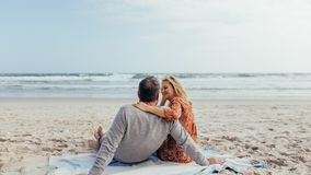 Mature couple spending time on the beach royalty free stock photo