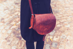 Rear view shot of woman with leather handbag Stock Photography