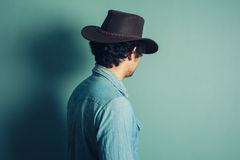 Rear view shot of young cowboy. Rear view shot of a young man wearing a cowboy hat Stock Photography
